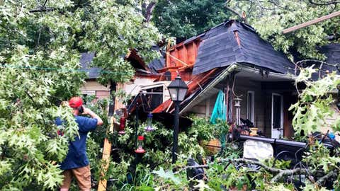 Firefighters from the Hobart Fire Department helped first responders in Lake Station, Indiana, rescue a man pinned to his couch after a tree fell on him home during the derecho storm on Monday, August 10, 2020. He was taken to a hospital with non-life-threatening injuries, the Times of Northwest Indiana reported. (Facebook/Hobart Fire Department)