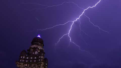 A lightning bolt strikes near the Palacio Salvo landmark building in Montevideo, Uruguay, on December 14, 2018. (Mariana Suarez SUAREZ /AFP/Getty Images)