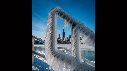Ice forms on a railing near Lake Michigan in Chicago, Ill., on Jan. 28, 2019, as the area faces the coldest Arctic outbreak in at least two decades. (Mike Wasserberger)