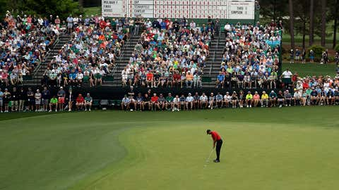 Tiger Woods putts on the 15th hole during the final round for the Masters golf tournament, Sunday, April 14, 2019, in Augusta, Ga. (AP Photo/Charlie Riedel)