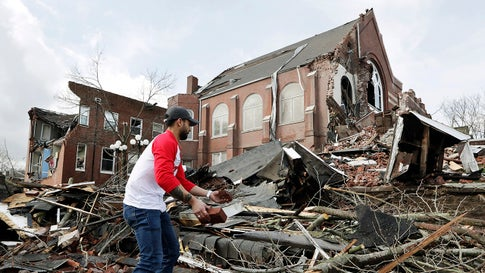 Sumant Joshi helps to clean up rubble at the East End United Methodist Church after it was heavily damaged by storms Tuesday, March 3, 2020, in Nashville, Tenn. Joshi is a resident in the area and volunteered to help clean up. Tornadoes ripped across Tennessee early Tuesday, shredding buildings and killing multiple people.  (AP Photo/Mark Humphrey)