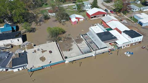 An aerial view of a flooded street after water from the Tittabawassee River breached the Edenville Dam on May 20, 2020, in Sanford, Michigan. (Photo by Gregory Shamus/Getty Images)