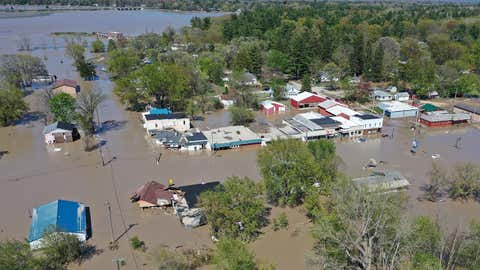 Aerial view of a flooded street in Sanford, Michigan, after water from the Tittabawassee River breached a nearby dam on Wednesday, May 20, 2020. (Photo by Gregory Shamus/Getty Images)