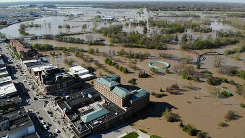 Floodwaters from the Tittabawassee River lap at businesses along Main Street in Midland, Michigan, on Wednesday, May 20, 2020. The green circle is Midland Farmers Market under 8 to 10 feet of water. (Photo courtesy of Ben Tierney)