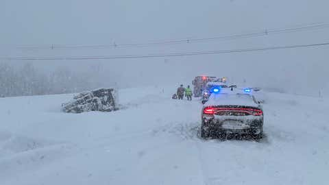 Members of the New Hampshire State Patrol are responding to a rollover accident involving a state snow plow truck on Thursday, December 17, 2020 in Grantham, New Hampshire.  Officials say no one was injured.  (Twitter / @NH_StatePolice)
