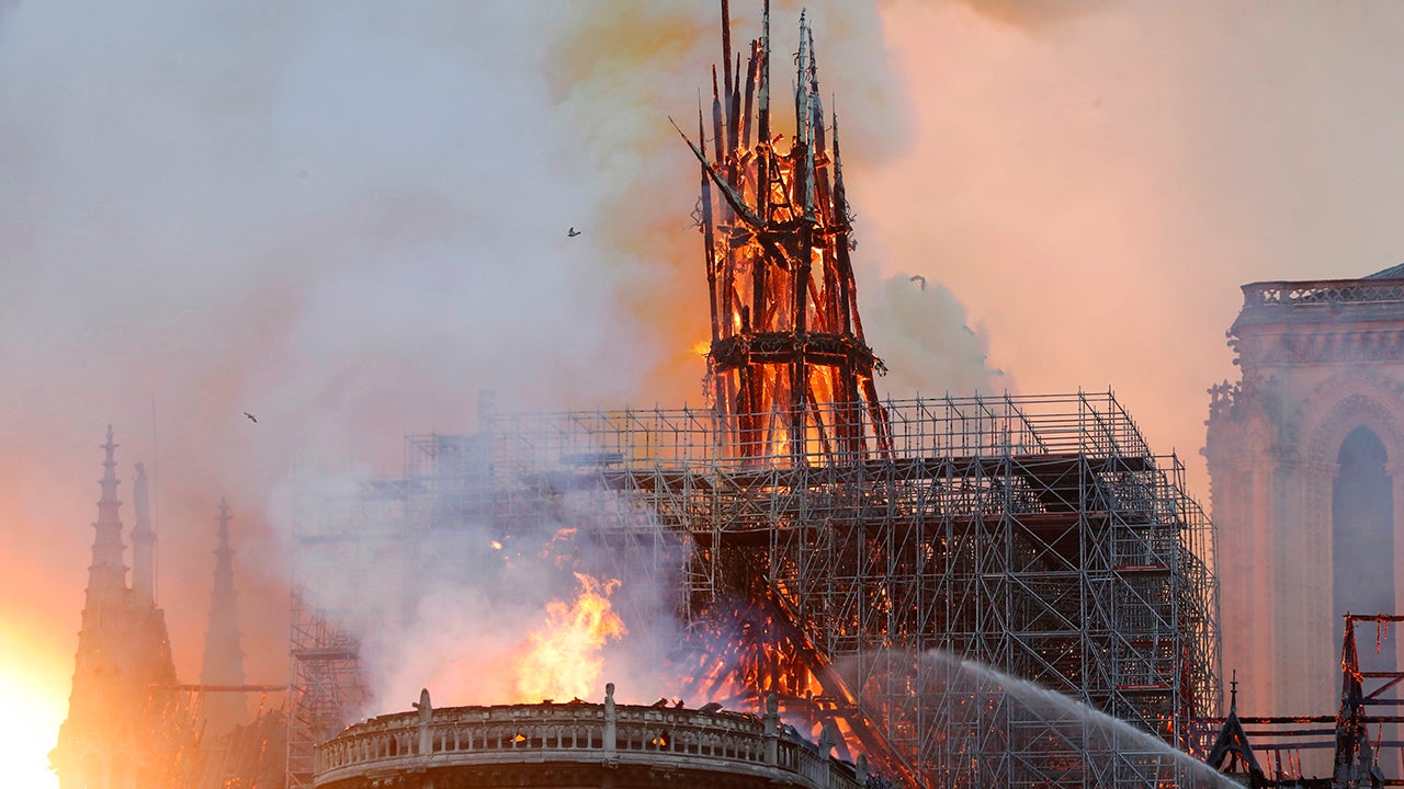 Smoke and flames rise during a fire at the landmark Notre Dame Cathedral in central Paris on Monday, April 15, 2019, potentially involving renovation works being carried out at the site, the fire service said. The spire, which was surrounded by scaffolding, collapsed in the fire. (Francois Guillot/AFP/Getty Images)
