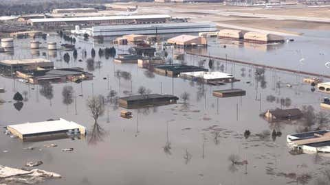 Floodwaters have covered about a third of Offutt Air Force Base in Bellevue, Nebraska, south of Omaha. About 3,000 feet of runway also has been flooded. (55th Wing Commander/Facebook)