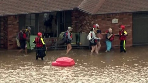 People are helped from their flooded home on Tuesday, May 21, 2019, near El Reno, Oklahoma. Numerous water rescues were needed in Canadian County. (KFOR)