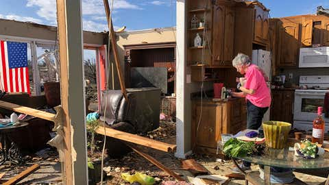 Patti Herring sobs as she sorts through the remains of her home in Fultondale, Ala., on Tuesday, Jan. 26, 2021, after it was destroyed by a tornado. (AP Photo/Jay Reeves)