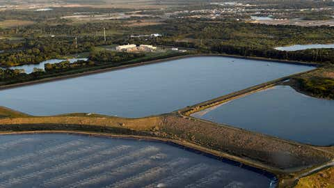 A reservoir near the old Piney Point phosphate mine was in danger of collapsing on Saturday, April 3, 2021 in Bradenton, Florida. Florida Gov. Ron DeSantis declared a state of emergency after a significant leak at the wastewater pond threatened to flood roads and homes and wash into Tampa Bay. (Tiffany Tompkins/The Bradenton Herald via AP)