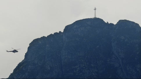 Rescuers in a helicopter check the slopes of the Giewont peak for missing persons and anyone who might need help in the Tatra Mountains in Poland, on Friday, August 23, 2019. Three people are still missing  after a deadly thunderstorm with multiple lightning strikes hit the Tatra Mountains, killing five people and injuring more than 150. 