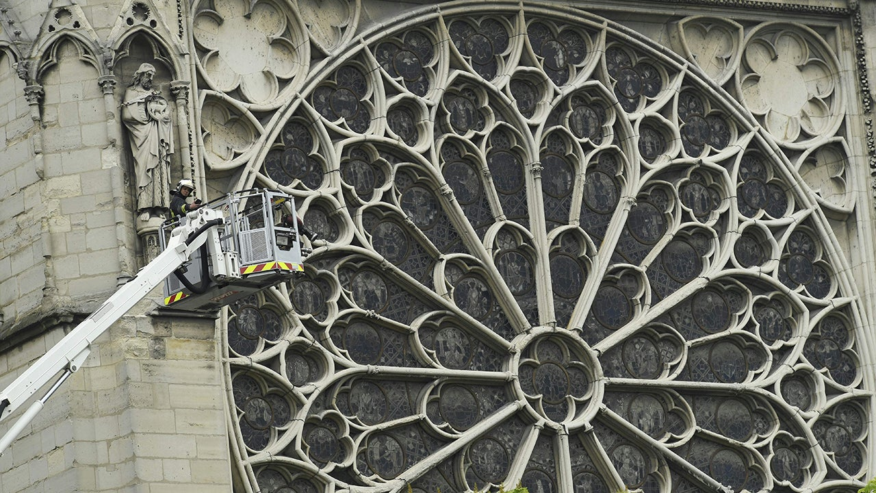 The famed rose windows at Notre Dame cathedral in Paris appear to have survived the fire, cathedral spokesman André Finot said Tuesday, April 16, 2019. (Bertrand Guay/AFP/Getty Images)