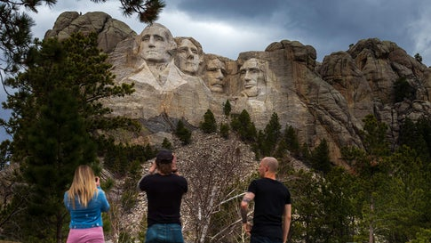 Tourists take photos of Mount Rushmore National Memorial on April 23, 2020, in Keystone, South Dakota. (Photo by KEREM YUCEL/AFP via Getty Images)