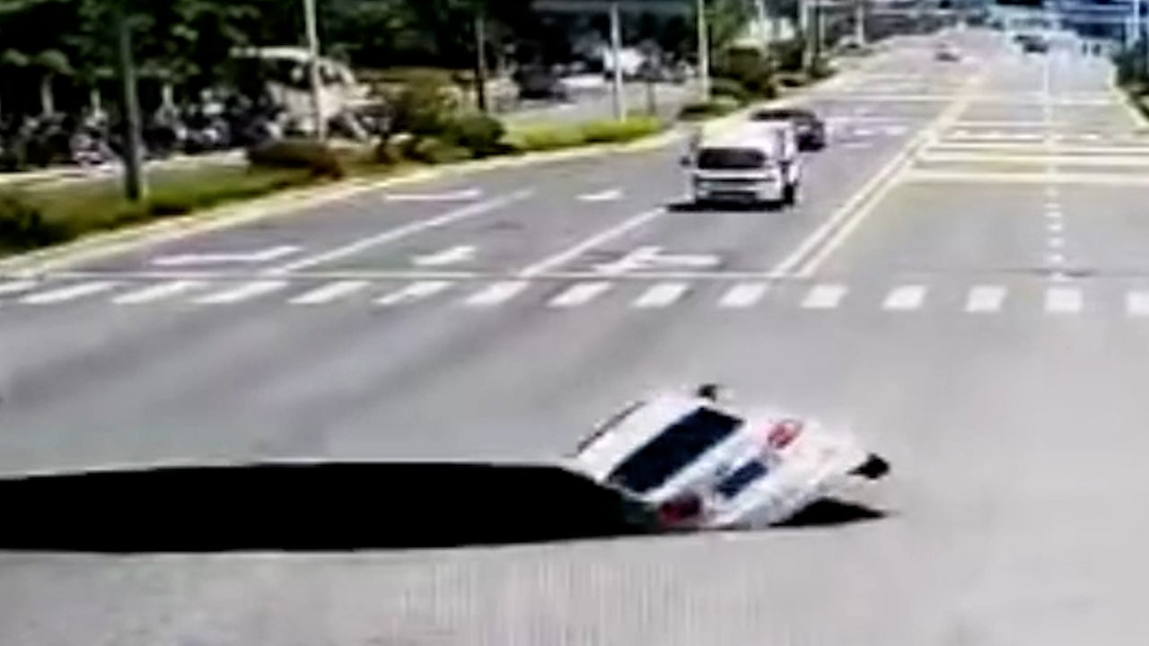 Monster Sinkhole Swallows Entire Car
