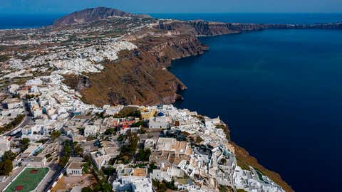 The town of Oia and Thyra on the island of Santorini, Greece. Some 2,000 residents of the island have signed a petition asking the government to finally remove a sunken cruise ship from the ancient caldera. (Photo by ARIS MESSINIS/AFP via Getty Images)