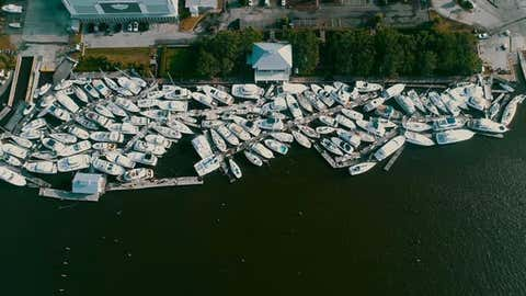 Dozens of boats are smashed against each other in the marina at Southport, North Carolina, on Tuesday, August 4, 2020, after Hurricane Isaias moved through the area overnight. (Twitter/@BarkleyMarine)