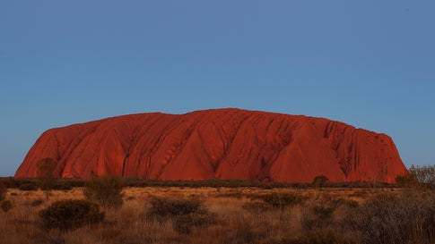 Uluru as seen from the sunset viewing area on August 13, 2019, in the Uluru-Kata Tjuta National Park, Australia. The Uluru-Kata Tjuta National Park board decided unanimously that the climb will close permanently on October 26, 2019. (Lisa Maree Williams/Getty Images)