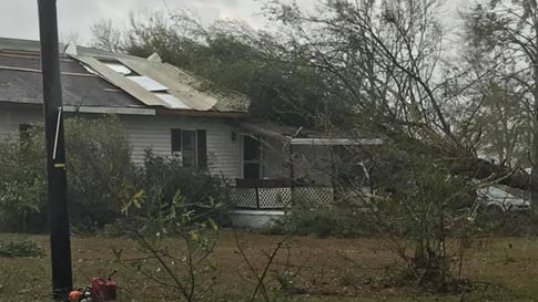 A tree lies across a home east of Rosepine, Louisiana, on Monday, December 16, 2019, after a tornado blew through Vernon Parish. (Facebook/Vernon Parish Sheriff's Office)