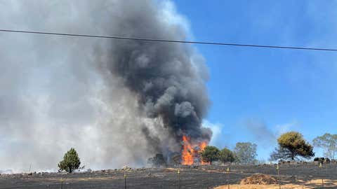 A fast-moving wildfire prompted evacuations in Yuba County, California, on Tuesday June 8, 2021. (@CALFIRENEU via Twitter)