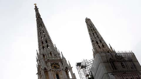 One of the damaged spires, right, of Zagreb's iconic cathedral is seen after an earthquake in Zagreb, Croatia, Sunday, March 22, 2020. The cathedral was rebuilt after it toppled in the 1880 earthquake. (AP Photo/Darko Bandic)
