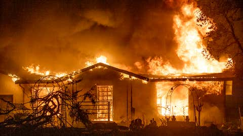 A house burns on Platina Road at the Zogg Fire near Ono, California, onSept. 27, 2020. Pacific Gas & Electric has been charged with manslaughter and other crimes in connectiton with the Northern California wildfire that killed four people and destroyed hundreds of homes.  (AP Photo/Ethan Swope, File)