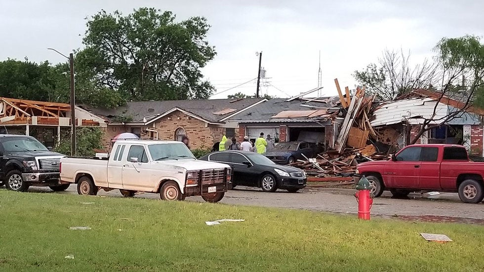 Tornadoes ripped open homes and flipped vehicles in Texas, Oklahoma and Arkansas