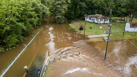 Men check out Greenwood Road, which is flooded by Chickahominy River, in Glen Allen on Friday morning, May 18, 2018.