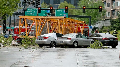 A construction crane fell into eastbound and westbound Mercer Street near Fairview Avenue East Saturday, April 27, 2019, in Seattle. Several people were killed and others wounded when a construction crane collapsed in downtown Seattle, pinning cars underneath. (Greg Gilbert/The Seattle Times via AP)
