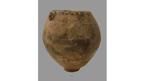 This undated photo provided by the National Museum of Georgia in November 2017 shows a Neolithic pottery vessel about 3 feet wide and 3 feet tall. Researchers announced that they have found shards of similar vessels, about 8,000 years old, south of Tblisi, Georgia. Patrick McGovern of the Penn Museum in Philadelphia says the pieces had come from the base of jars that were probably used for fermentation and storage of wine. (National Museum of Georgia via AP)