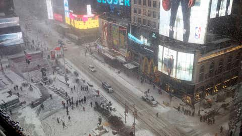 Snow falls over Times Square, Thursday, Jan. 4, 2018, in New York. A massive winter storm swept from the Carolinas to Maine on Thursday, dumping snow along the coast and bringing strong winds that will usher in possible record-breaking cold. (AP Photo/Mary Altaffer)