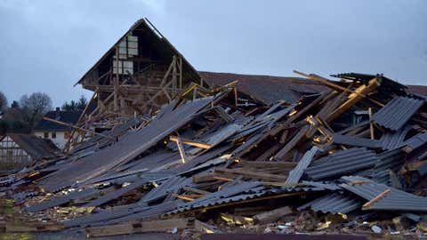 An agricultural building is collapsed during a heavy storm in Meimbressen, central Germany, Thursday, Jan. 18, 2018. (Uwe Zucchi/dpa via AP)