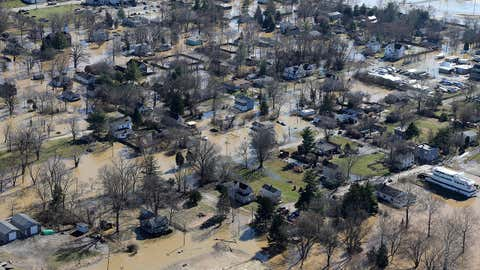 This aerial photograph shows flood damage from the swollen Ohio River of Cincinnati's California neighborhood, Monday, Feb. 26, 2018. Forecasters expect flooding to persist through the week in the Cincinnati region, and authorities said Monday that will hinder efforts to assess damage. (Kareem Elgazzar/The Cincinnati Enquirer via AP)