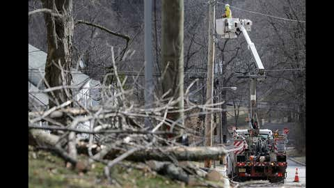 A man works on power lines in Morristown, N.J., Monday, March 5, 2018. Tens of thousands of New Jersey residents remain without power and emergency officials are watching coastal areas for flooding following a powerful storm. (AP Photo/Seth Wenig)