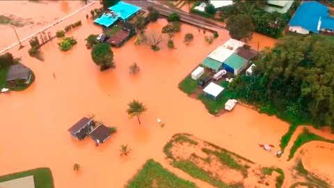 This Sunday, April 15, 2018 image taken from video provided by the U.S. Coast Guard shows flooding along Kauai's Hanalei Bay, Hawaii. (Petty Officer 3rd Class Brandon Verdura/U.S. Coast Guard via AP)
