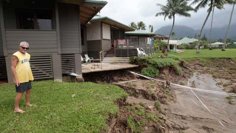 Richard Morris looks at the flood damage to his sister's home on Monday, April 16, 2018, in Hanalei, Kauai. (Jamm Aquino/Honolulu Star-Advertiser via AP)