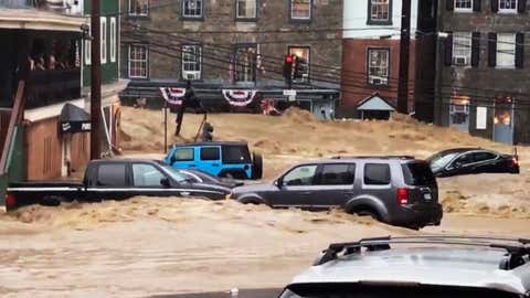 Water rushes through Main Street in Ellicott City, Md., Sunday, May 27, 2018. Flash flooding and water rescues are being reported in Maryland as heavy rain soaks much of the state. (Libby Solomon/The Baltimore Sun/AP Photo)