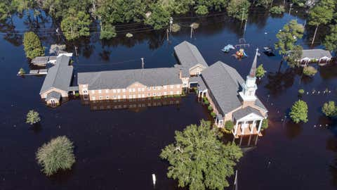 Trinity Methodist Church on Long Avenue is surrounded by floodwaters as the Waccamaw River crested at more than 21 feet in Conway, South Carolina, Wednesday, Sept. 26, 2018. (Jason Lee/The Sun News via AP)