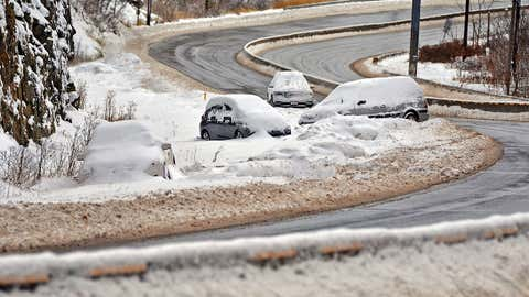 Stranded cars from Thursday's snowstorm sit along Northern Boulevard in Scranton, Pa., on Friday, Nov. 16, 2018. The first snowstorm of the season caused havoc around Pennsylvania, downing trees and power lines and causing a travel nightmare, including for some drivers who were stuck for 12 hours on a snowy interstate.   (Butch Comegys/The Times-Tribune via AP)