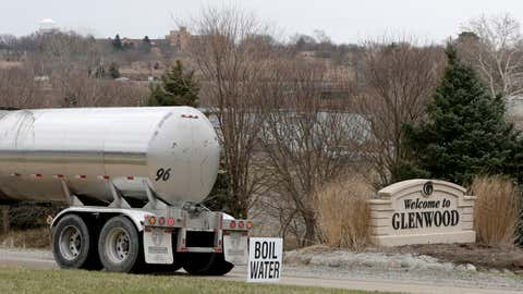 """A tanker drives by a """"Boil Water"""" sign at the entrance to Glenwood, Iowa, Wednesday, April 3, 2019. Glenwood's wells and water-treatment plant were inundated by flood waters and residents are being asked to boil their water. Several communities along the Missouri River continue to struggle to restore drinking water service weeks after massive flooding disrupted life in the towns and caused significant damage. (AP Photo/Nati Harnik)"""
