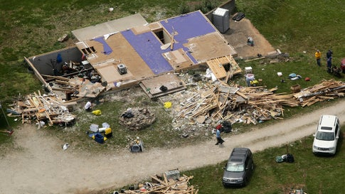 Cleanup continues at a destroyed home Thursday, May 30, 2019, after an EF-4 tornado tore through the countryside near Linwood, Kan., Tuesday, May 28. (AP Photo/Charlie Riedel)