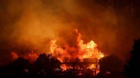 A structure is engulfed by the advancing Maria Fire Thursday, Oct. 31, 2019, in Somis, Calif. (AP Photo/Marcio Jose Sanchez)