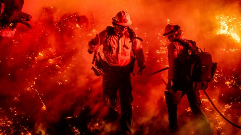 Firefighter Giannis Giagos battles the Maria Fire in Santa Paula, Calif., on Friday, Nov. 1, 2019. According to Ventura County Fire Department, the blaze has scorched more than 8,000 acres and destroyed at least two structures. (AP Photo/Noah Berger)