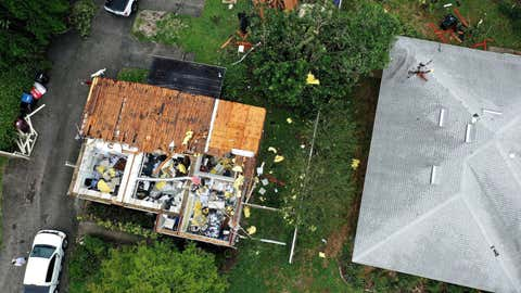 An aerial view shows a building housing that had its roof blown off during a tornado spawned by Tropical Storm Cristobal. The EF1 tornado passed through Orlando, Florida, leaving at least 8 homes damaged, along with numerous reports of downed trees and power lines. No injuries have been reported. (Paul Hennessy / SOPA Images/Sipa USA via AP Images)
