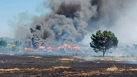 In this photo provided by the California Department of Forestry and Fire Prevention, the Nelson Fire burns Wednesday, June 17, 2020, near Oroville, Calif. Some residents of a Northern California county devastated by wildfire in 2018 are under evacuation orders because of a grass fire that has so far destroyed four homes. An evacuation order for parts of Oroville was issued after noon and the cause of the fire is under investigation. A 2018 wildfire in Butte County killed 85 people and destroyed more than 18,000 homes and buildings. (California Department of Forestry and Fire Prevention via AP)