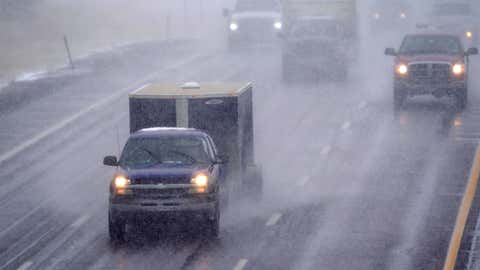 Motorists guide their vehicles along Interstate 70 as a storm packing high winds and snow sweeps through the intermountain West, Tuesday, Sept. 8, 2020, in Georgetown, Colo. Forecasters predict that the storm will continue through Wednesday before moving out on to the plains. (AP Photo/David Zalubowski)