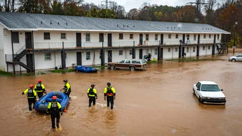 Firefighters with the Winston-Salem Fire Department arrive at Creekwood Apartments to assist with evacuations due to flooding on Thursday, Nov. 12, 2020 in Winston-Salem, N.C. (Andrew Dye/The Winston-Salem Journal via AP)