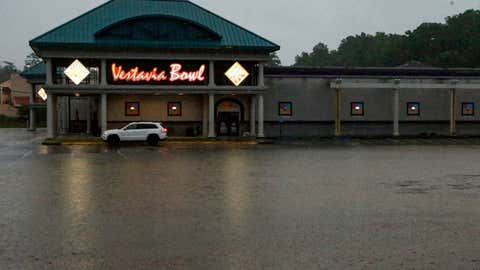 A parking lot is flooded as severe weather produces torrential rainfall, Tuesday, May 4, 2021 in Vestavia, Ala. (AP Photo/Butch Dill)