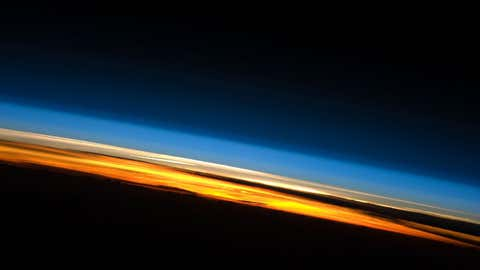 Layers of earth's atmosphere are shown in a view looking across the planet's surface from the International Space Station. (NASA)