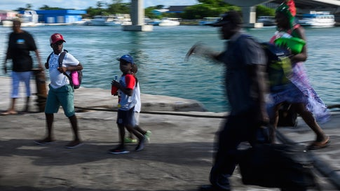 """Evacuees get off a ferry after leaving Marsh Harbour on Abaco island in the aftermath of hurricane Dorian in Nassau, Bahamas on September 9, 2019. - President Donald Trump said Monday that the US would have to be careful about allowing Bahamian survivors of Hurricane Dorian into the country, warning there could be """"very bad people"""" among them. The previous day, several hundred storm survivors were prevented from boarding a ferry from the Bahamas to Florida because they lacked US visas -- an incident that a top American immigration official said was a mistake. (Photo by ANDREW CABALLERO-REYNOLDS / AFP)        (Photo credit should read ANDREW CABALLERO-REYNOLDS/AFP/Getty Images)"""
