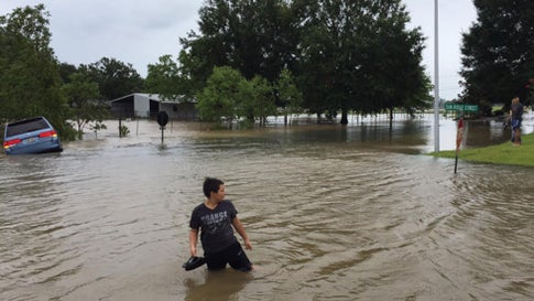 A man stands on a flooded street Sunday July 14, 2019, in the Highland Ridge Subdivision in Youngsville, Louisiana. Photo courtesy Mark Hargrave